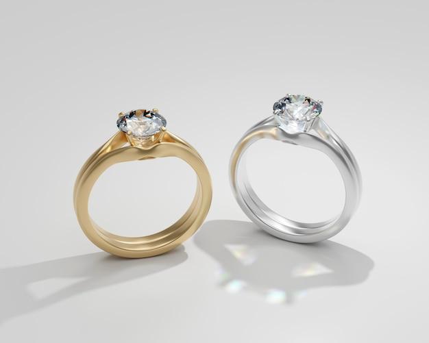Diamanten ring paar goud en zilver geïsoleerd op een witte achtergrond 3d render