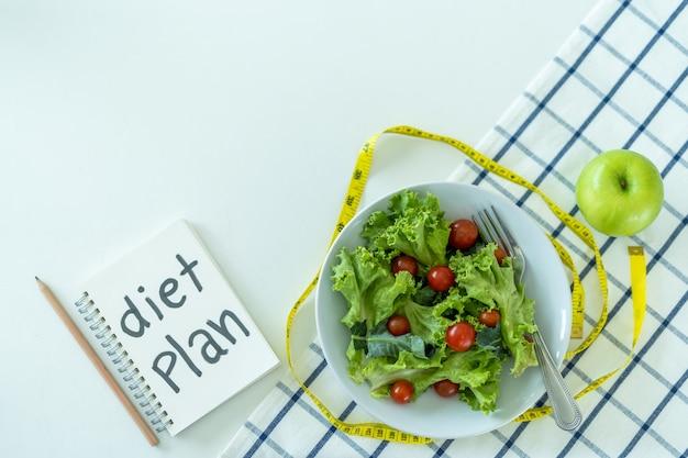 Dieetplanning of dieetcontrole programma- en meetlint-etalagepoppenprogramma