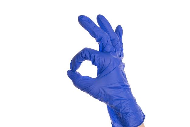 Dien medische handschoen in die ok teken maakt