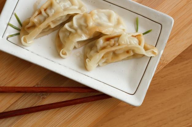 Dim sum oproep gyoza, aziatisch traditie voedsel