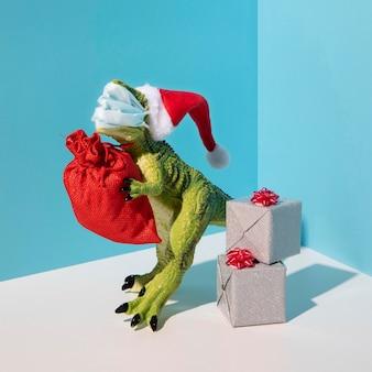 Dinosaurusstuk speelgoed dat medisch masker draagt