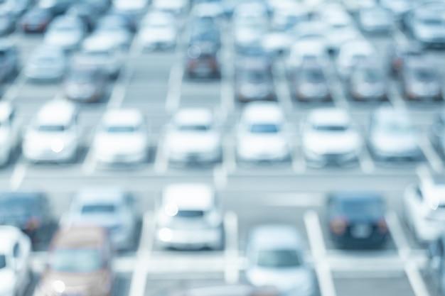 Disfocut van auto parkeren achtergrond
