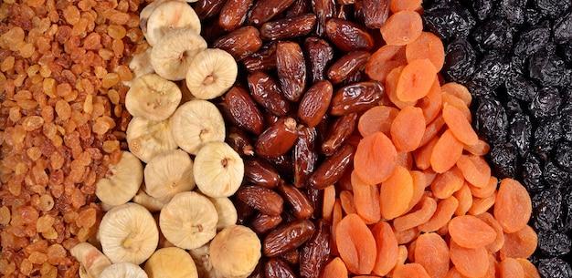 Diverse gedroogde vruchten als achtergrondtextuur