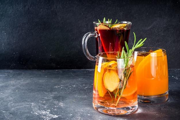 Diverse herfstcocktails glühwein, gemberbier, hete beboterde rum, punch, cider, sangria