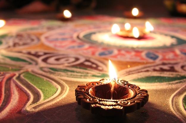 Diya on rangoli at diwali in india