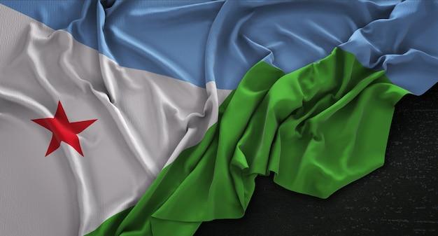 Djibouti vlag gerimpelde op donkere achtergrond 3d render