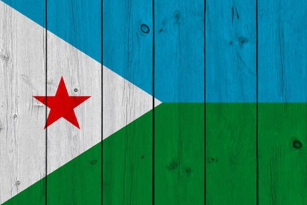 Djibouti vlag geschilderd op oude houten plank