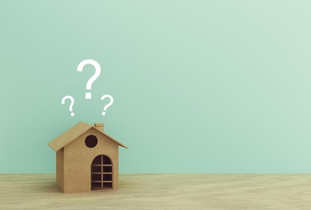 Document huismodel met vraagtekens op houten lijst met blauw. copyspace.