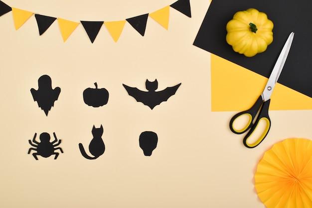 Doe het zelf. we maken een decor van gekleurd papier voor een feestelijke decoratie voor halloween. stapsgewijze instructies.