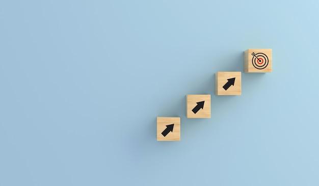 Doelbord houten kubus op pijlen omhoog. doel van het succesproces voor investeringen en bedrijfsconcepten. rode pijl. 3d-rendering.