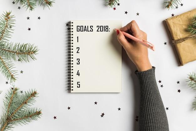 Doelen plannen dromen maken om lijst voor het nieuwe concept van het jaarkerstmis schrijven te doen