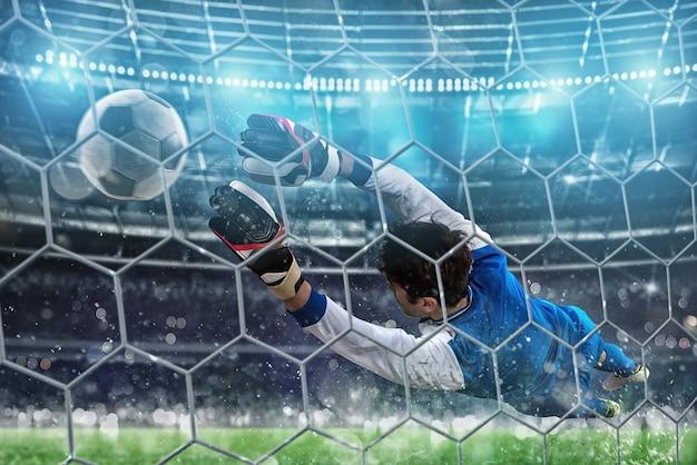 Doelman vangt de bal in het stadion tijdens een voetbalwedstrijd.