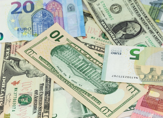 Dollar en euro bankbiljettenachtergrond, bedrijfsfinanciënconcept
