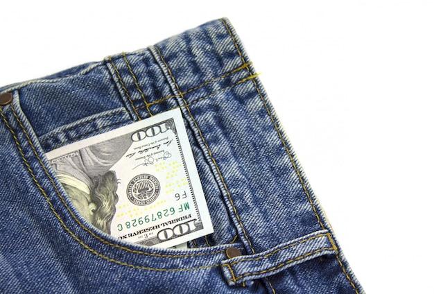 Dollars in de achterzak jeans. zakgeld concept