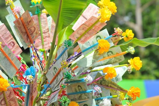 Donation merit money tree bij thai temple.