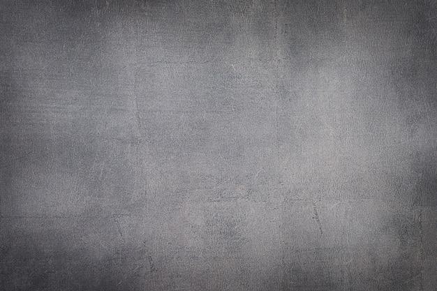 Donker getextureerd bruin stenen betonnen oppervlak