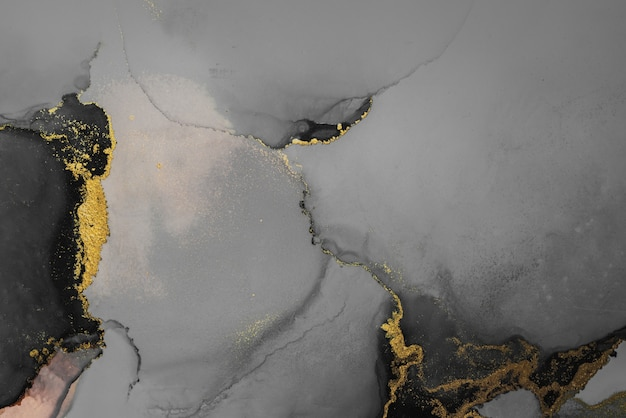 Donker goud abstracte achtergrond van marmeren vloeibare inkt kunst schilderij op papier.