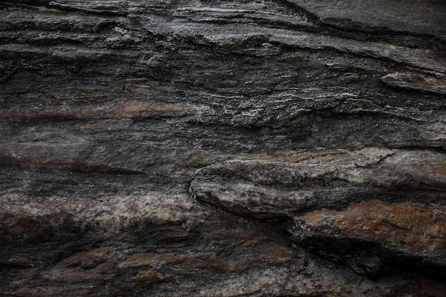 Donker grijze zwarte leisteen steen textuur achtergrond.