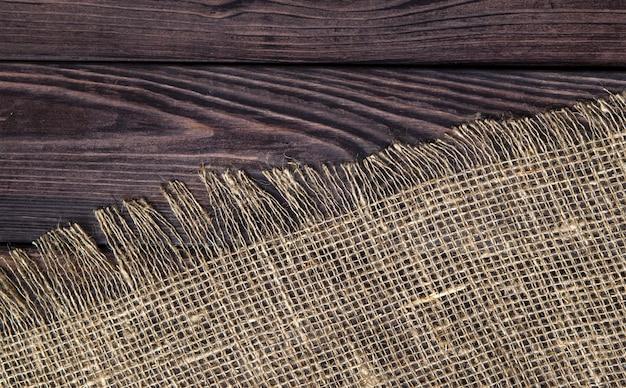 Donker hout met oude jute textuur, bovenaanzicht