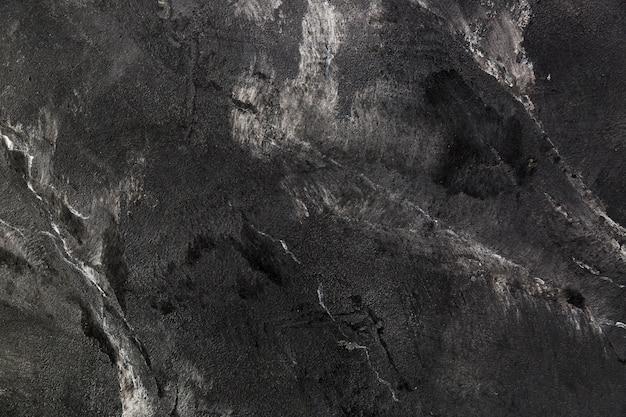 Donker leisteenoppervlak met scheuren