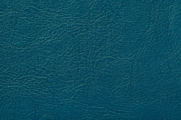 Donker marineblauw lederen textuur achtergrond turquoise gebarsten achtergrond van rimpels