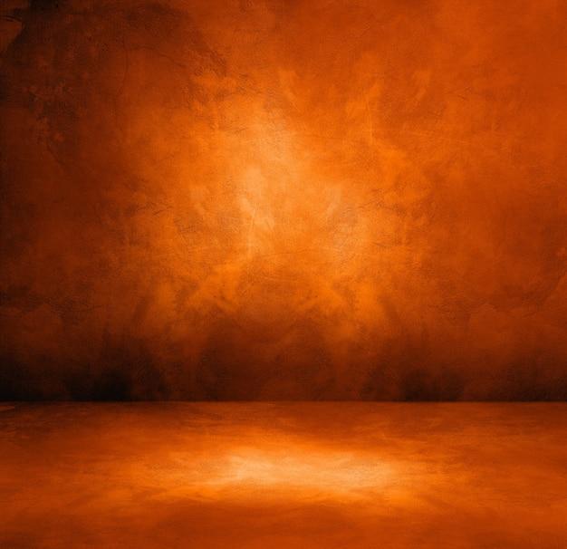 Donker oranje betonnen interieur achtergrond. lege sjabloonscène
