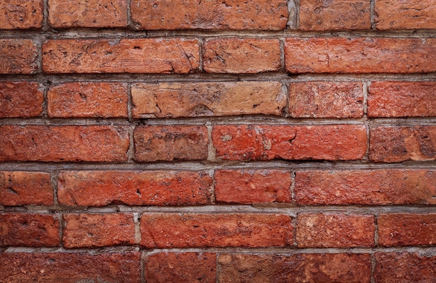Donker rode grunge bakstenen muur textuur in vintage stijl.
