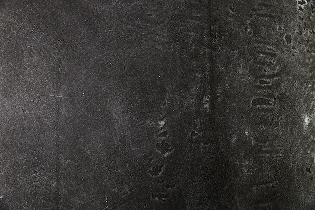 Donker ruw betonnen oppervlak