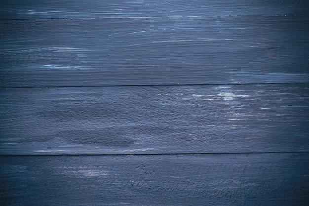 Donkerblauwe achtergrond van geschilderde planken