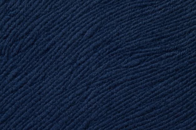 Donkerblauwe achtergrond van zacht textiel, stof met natuurlijke textuur,
