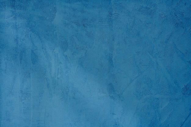 Donkerblauwe betonnen gestructureerde achtergrond
