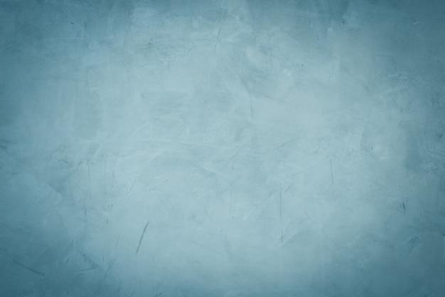 Donkerblauwe cementmuur en uitstekende achtergrondachtergrond