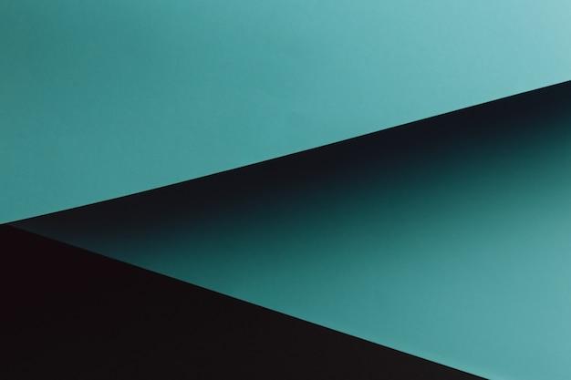 Donkerblauwe en zwarte plat lag achtergrond met scherpe lagen en schaduwen met kopie ruimte