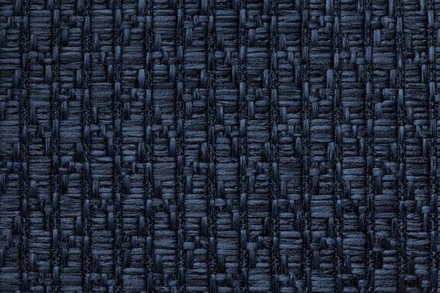Donkerblauwe gebreide wollen achtergrond met een patroon