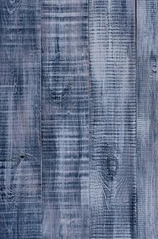 Donkerblauwe houten achtergrond gemaakt van een breed bord, geschilderd in donkerblauw.