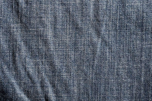 Donkerblauwe jeanstextuur en textielstof