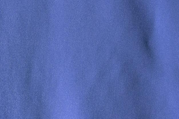 Donkerblauwe stof doek polyester textuur en textiel achtergrond.