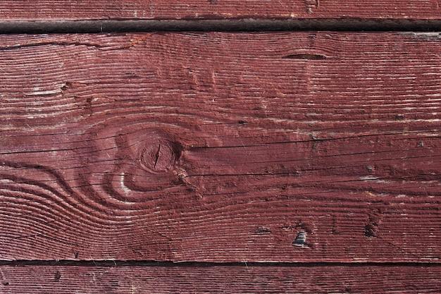 Donkerbruin bekraste houten plank. hout textuur. achtergrond houten bord met gebarsten verf. kleur - schil de houtstructuur