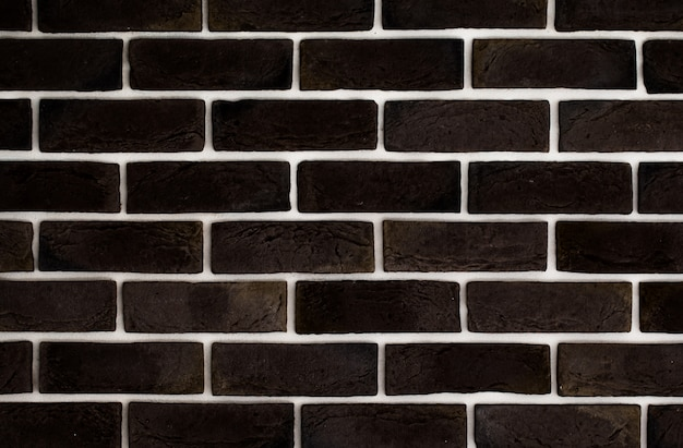 Donkerbruine bakstenen muur, creatieve back-phonon, close-up