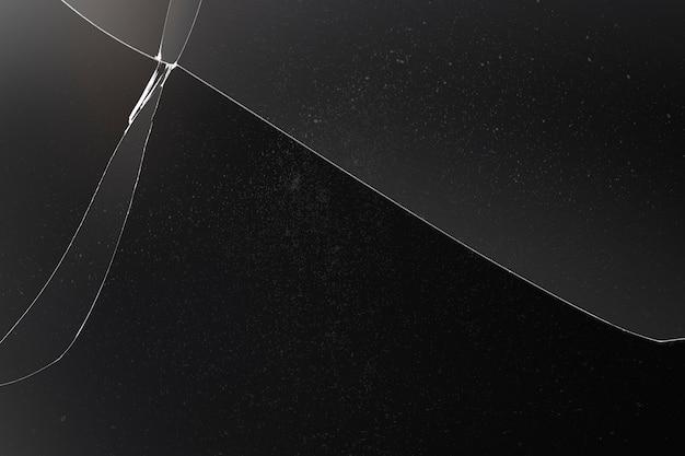 Donkere achtergrond met gebarsten glastextuur