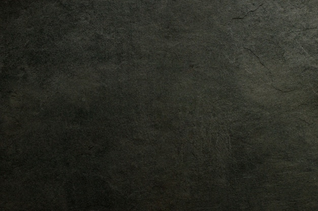 Donkere betonnen getextureerde muur achtergrond