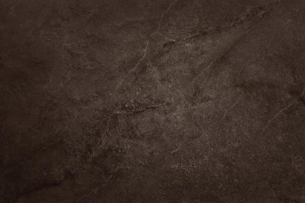 Donkere bruine leistructuur, achtergrond van natuurlijke zwarte steenmuur.