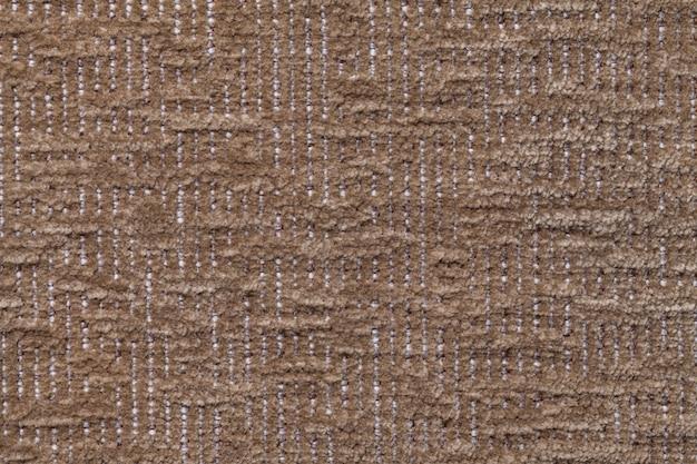 Donkere bruine pluizige achtergrond van zachte, wollige doek. textuur van pluchebonttextiel, close-up.