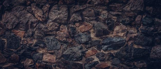 Donkere bruine stenen muur textuur achtergrond