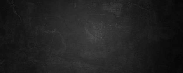 Donkere en zwarte beton- en cementmuur om product en achtergrond te presenteren