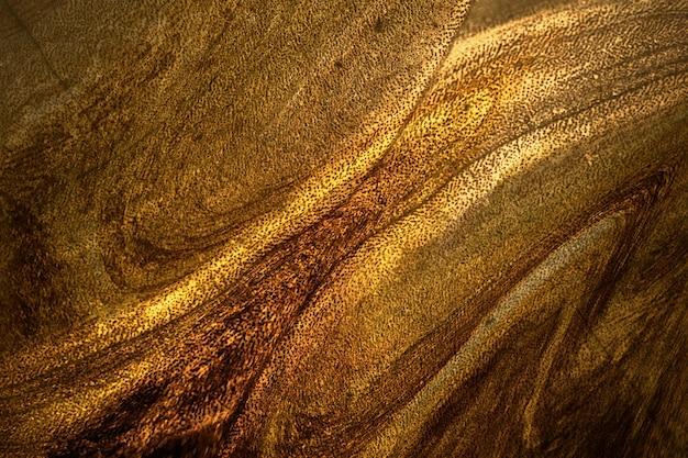 Donkere gouden verf getextureerde achtergrond Premium Foto