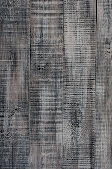 Donkere houten achtergrond gemaakt van een breed bord, geschilderd in donkerbruin.