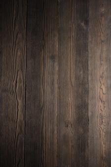 Donkere houten tafel in verticale