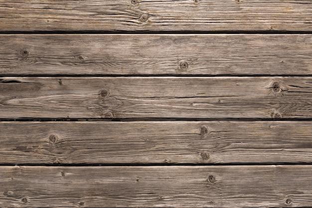 Donkere houten textuur als achtergrond. oude hek panelen
