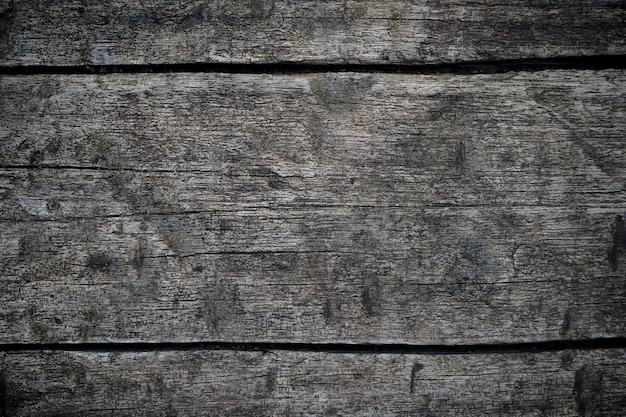 Donkere houten textuuroppervlakte als achtergrond met oud natuurlijk patroon. close-up van zwarte muur houtstructuur achtergrond (kruiselings)
